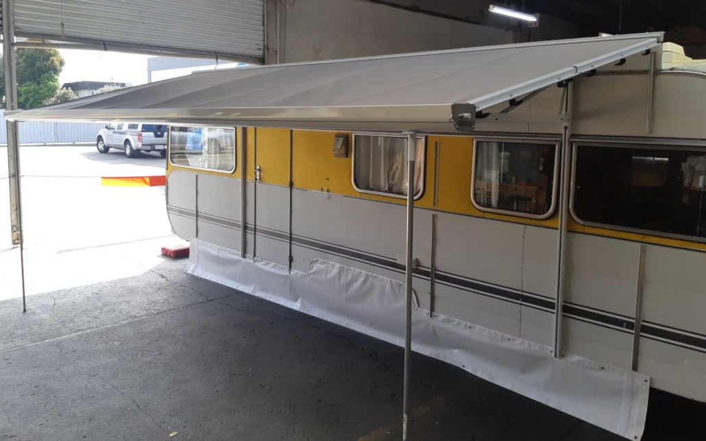 Caravan with retractable awning by Douglas