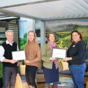Douglas Owners Pete and Suzanne presenting Donation Plaques to Christina McBeth of Nourished for Nil and Amber McArther from NZ Red Cross Hawkes Bay