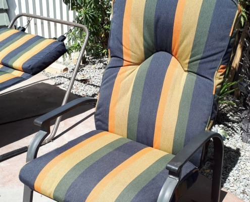 Close up of chair with lounger behind