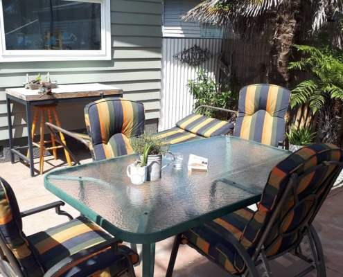 Outdoor chair upholstery table setting Napier Hastings NZ