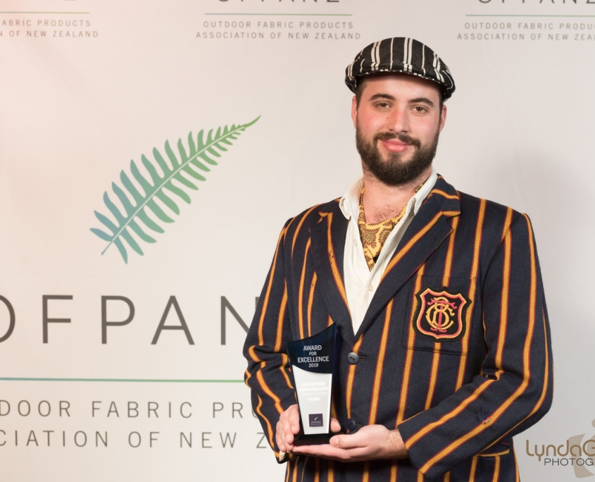 Fabricator Jason Muir accepts the OFPANZ Marine Upholstery Excellence Award 2019 for Douglas Innovation