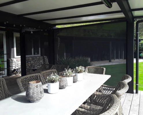 With outdoor screens down everyone inside is protected on this Havelock North Hawkes Bay installation by Douglas